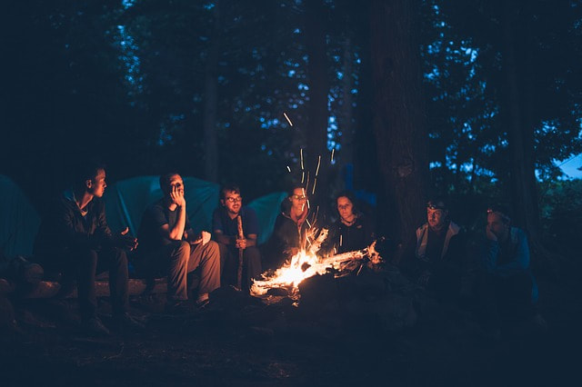 A group around the campfire