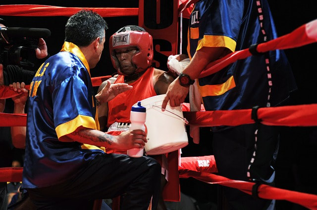 AA PUGILIST (BOXER) ENTERING THE RING.