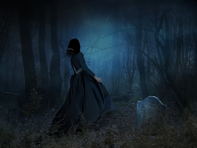 A widow at an open grave