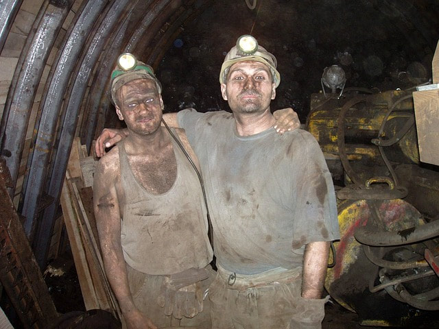 Miners emerging from a mine